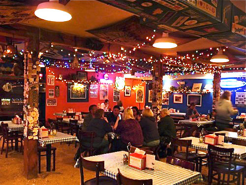 The interior of Klondike Pizza takes you straight to Alaska, with endless displays of artifacts and a unique decor.