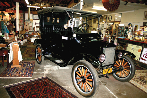 A 1921 Model T greets entering visitors.