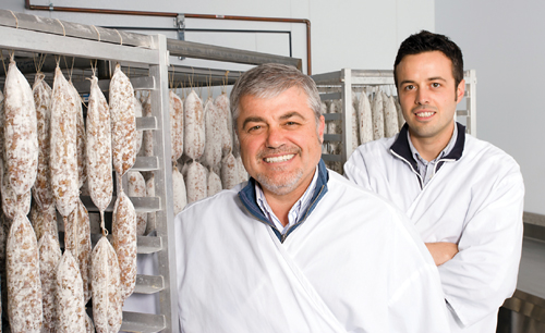 Buona Tavola Chef-Owner Antonio Varias (front) features salami at his recently-opened  Alle-Pia Fine Cured Meats. His nephew, Alex Pellini, has been instrumental in the  creation and supervision of the salami production.