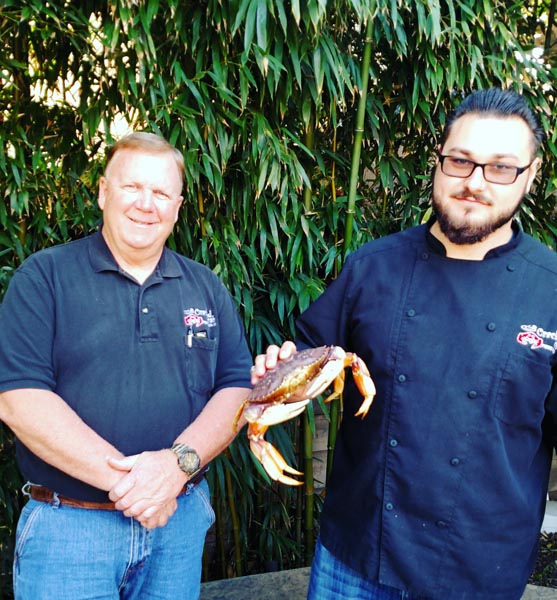 Kevin Hyland and Svyatoslav Popovich with a dungeoness crab.