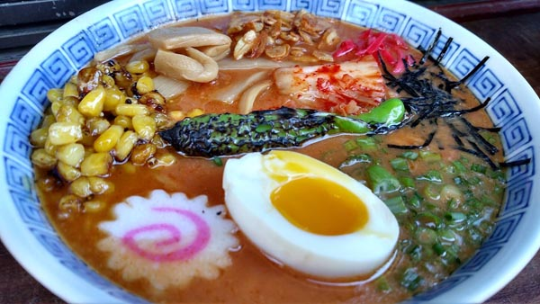 Individuality is the name of the game when it comes to Kuma ramen – diners have their choice of broth, meat, and add-ons including garlic chips, tofu, and spicy kimchi.