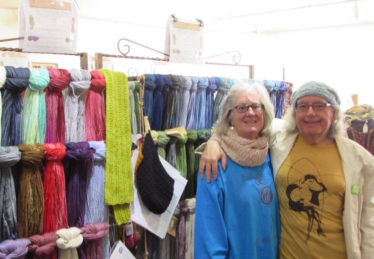 Skeins of luxuriously textured yarn from spinners and dyers around the world hang from the racks. Owners, Kris Gregson and Oz Barron welcome everyone.